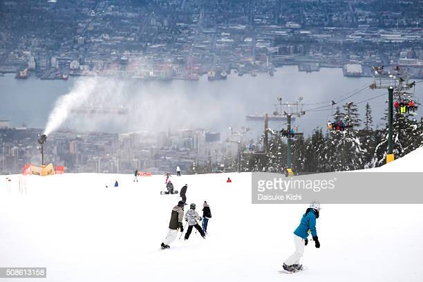 snowboarders and the view from grouse mountain, vancouver - grouse mountain stock photos and pictures