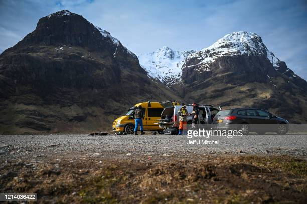 Snowboarders assemble in a car park as members of the public are asked to stop traveling to the Scottish Highlands in a bid to avoid spreading the...