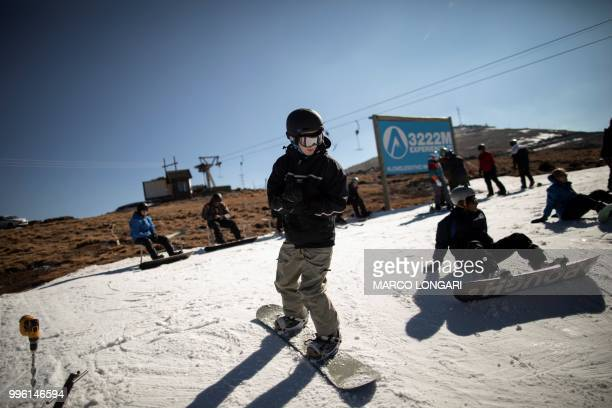 Snowboarders gather at the top of the main 1km slope at the Lesotho Kingdom ski resort Afriski in the Maluti Mountains on July 11 2018 Nestled high...