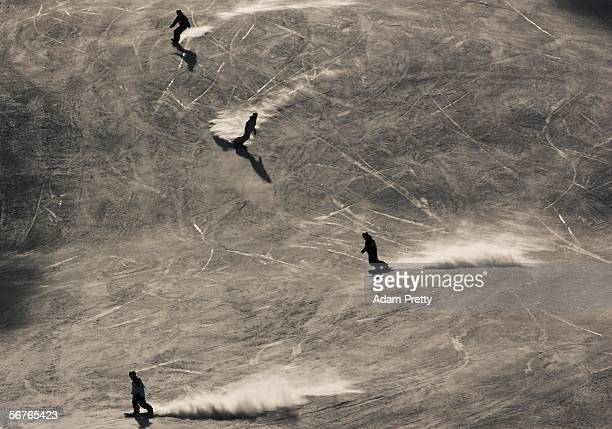 Snowboarders ride down the slopes during training prior to the Turin 2006 Winter Olympic Games on February 7 2006 in Bardonecchia Italy The opening...