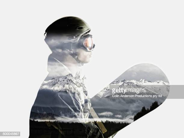 snowboarder's silhouette in reflection of snowy mountains - protective sportswear stock pictures, royalty-free photos & images
