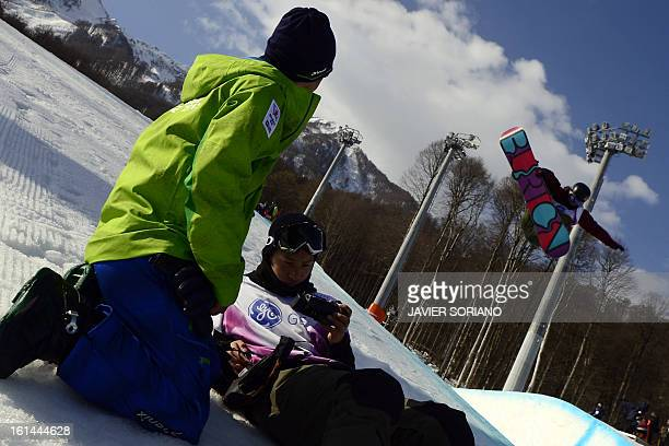 Snowboarders take part in a training session during the Snowboarding World Cup Test Event at Snowboard and Free Style Center in Rosa Khutor near...