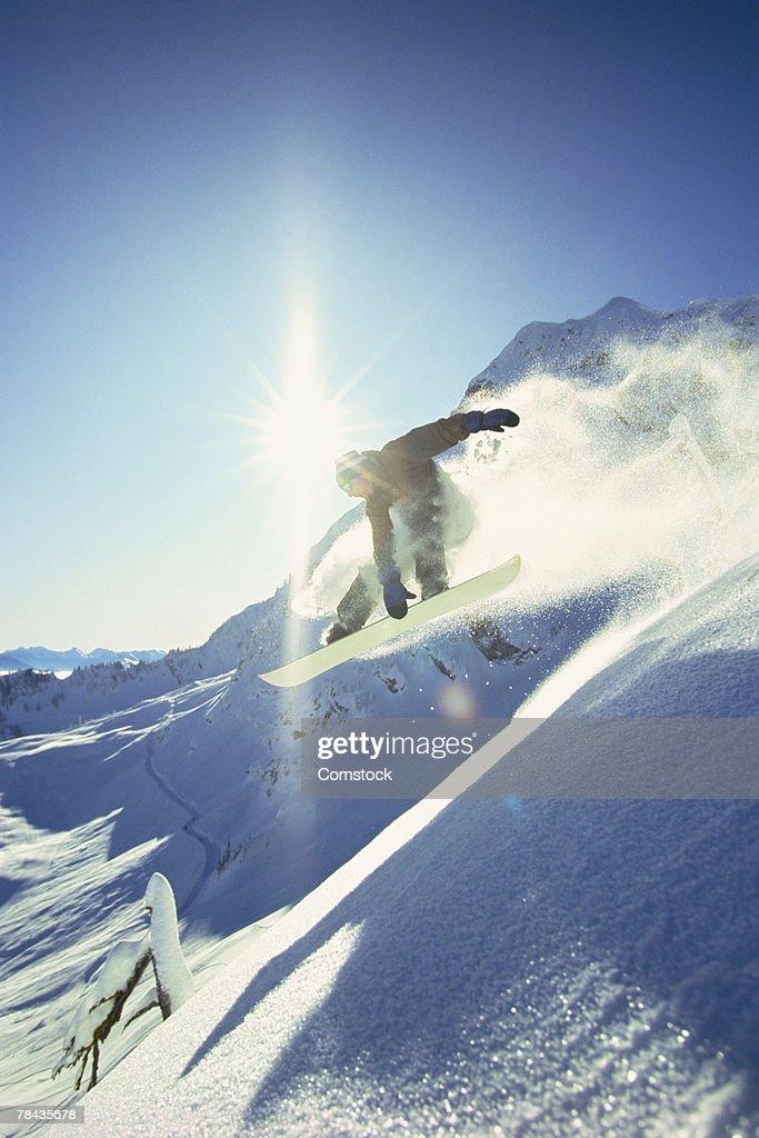 Snowboarding doing trick : Stockfoto