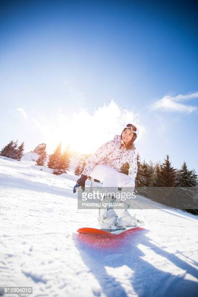 snowboarding downhill - female skier stock pictures, royalty-free photos & images