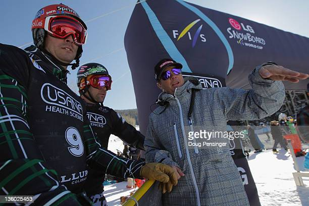 Snowboarding head coach Peter Foley discusses the course with Seth Wescott and Nick Baumgartner during the LG Snowboard-Cross FIS World Cup on...