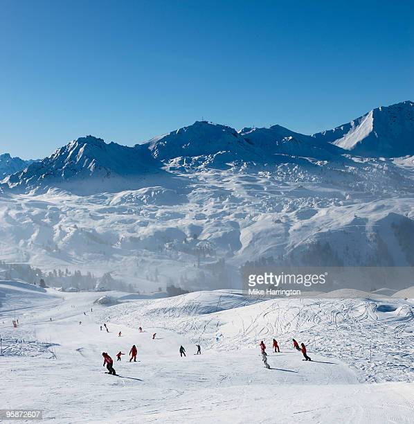 snowboarding in la plagne, france - la plagne stock photos and pictures