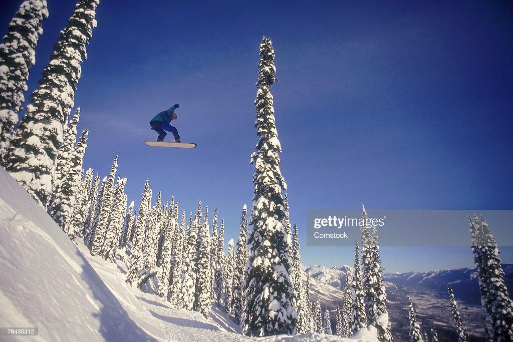 Snowboarding jumping through air , British Columbia , Canada : Stockfoto