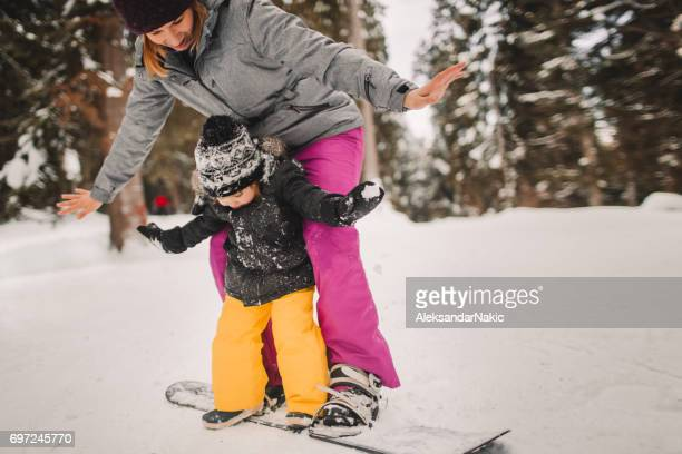 snowboarding lesson - snowboarding stock pictures, royalty-free photos & images