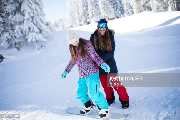 snowboarding lesson - ski holiday stock photos and pictures