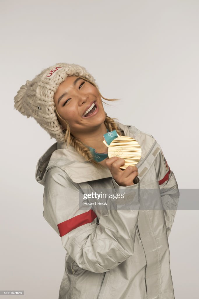 Portrait of USA Chloe Kim posing with gold medal during photo shoot at Los Coyotes Country Club. Kim won gold in the Women's Halfpipe during the 2018 Winter Olympics in PyeongChang. Robert Beck TK1 )