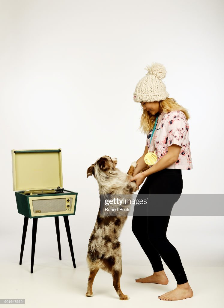 Portrait of USA Chloe Kim posing with her Australian shepherd dog Reese and gold medal during photo shoot at Los Coyotes Country Club. Kim won gold in the Women's Halfpipe during the 2018 Winter Olympics in PyeongChang. Cover. Robert Beck TK1 )