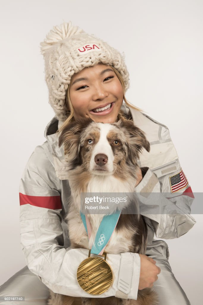 Portrait of USA Chloe Kim posing with her Australian shepherd dog Reese and gold medal during photo shoot at Los Coyotes Country Club. Kim won gold in the Women's Halfpipe during the 2018 Winter Olympics in PyeongChang. Robert Beck TK1 )