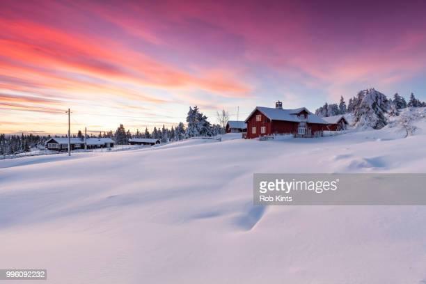 snowbound village after sunset - 深い雪 ストックフォトと画像
