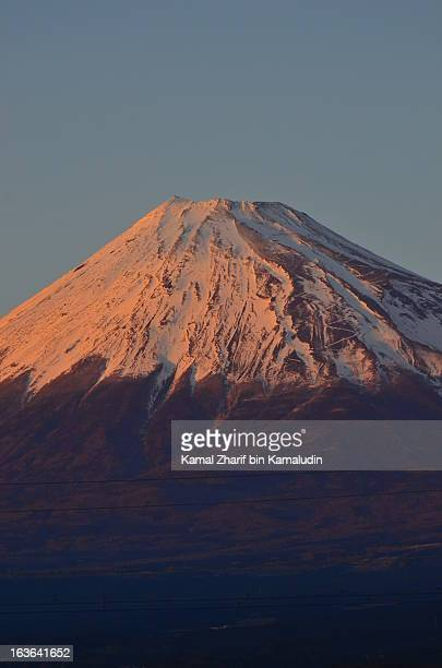 snowcapped cone of an extinct volcano - mishima city stock photos and pictures