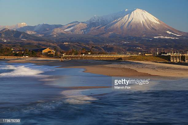 snow-capped daisen from kaike - yonago stock photos and pictures