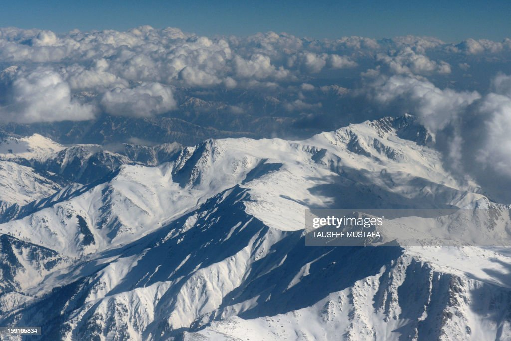 Snow-capped Himalayan mountains in the disputed Kashmir region are pictured during a commercial flight from Srinagar to Jammu on January 9, 2013. India delivered a dressing-down to Islamabad's envoy to Delhi as it accused Pakistan's army of beheading one of two soldiers killed in Kashmir, but both sides warned against inflaming tensions. AFP PHOTO/Tauseef MUSTAFA