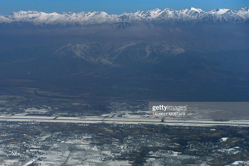 Snow-capped Himalayan mountains in the Kashmir region are pictured during a commercial flight from Jammu to Srinagar on January 22, 2013. The Kashmir valley continues to shiver as minimum temperatures in the region plummeted several degrees below freezing, a local report said. AFP PHOTO/Tauseef MUSTAFA