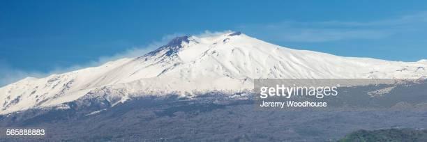 Snow-capped Mount Etna in remote landscape