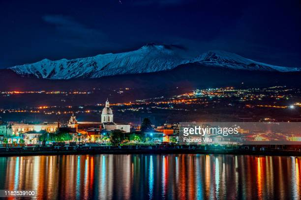 A snowcapped Mount Etna is seen from the port of Riposto on November 15 2019 in Catania Italy The volcano is currently emitting a slight emission of...