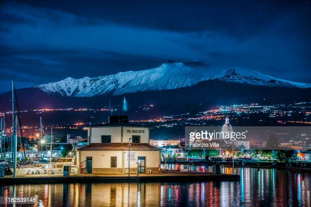 Snow-capped Mount Etna is seen from the port of Riposto on November 15, 2019 in Catania, Italy. The volcano is currently emitting a slight emission...