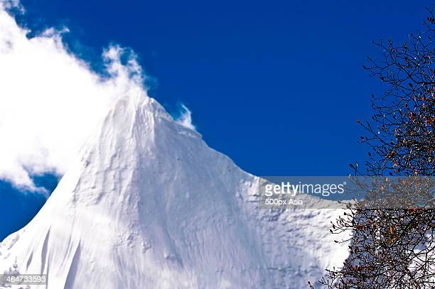 snow-capped mountain in daocheng yading - image stock pictures, royalty-free photos & images