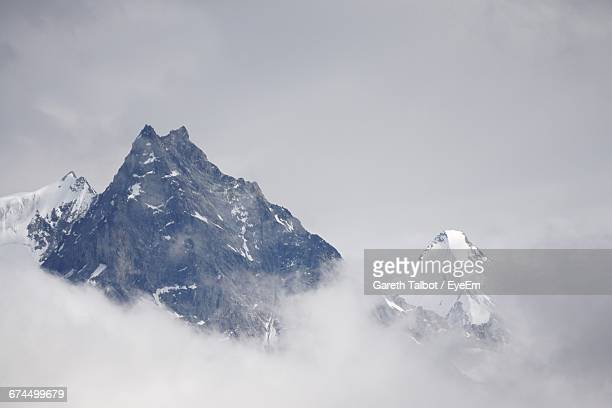 Snowcapped Mountain Peak Against Sky