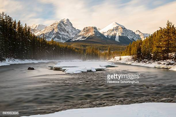 Snow-capped mountain peaks and river in winter