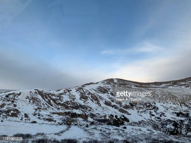 snowcapped mountains against sky - mack stock pictures, royalty-free photos & images