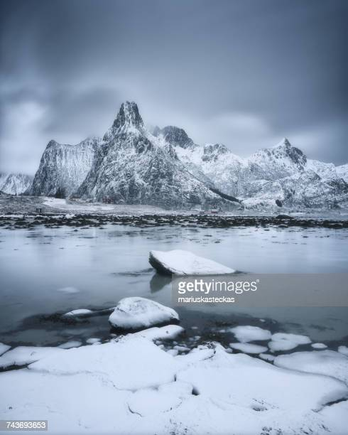 Snowcapped mountains and fjord, Lofoten, Norway