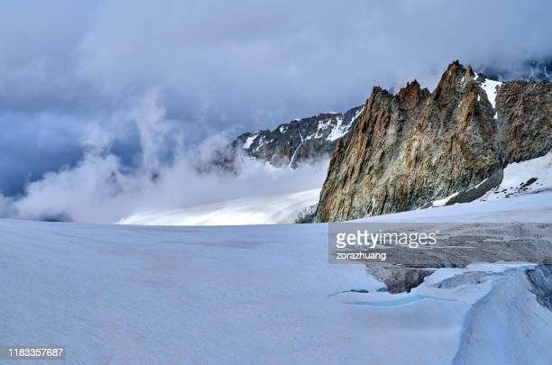 snow-capped mountains at morning fog, european alps - romantic sky stock pictures, royalty-free photos & images