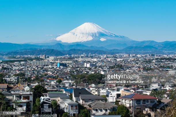 snow-capped mt. fuji and residential district in kanagawa prefecture of japan - chigasaki stock pictures, royalty-free photos & images