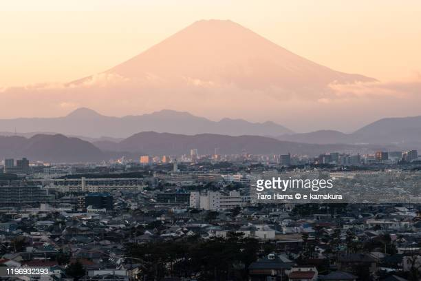 snow-capped mt. fuji and residential districts in kanagawa prefecture of japan - chigasaki stock pictures, royalty-free photos & images