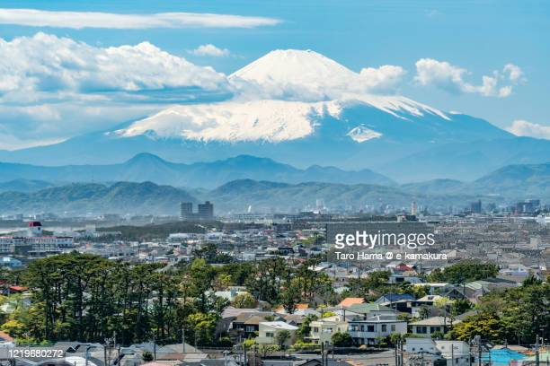 snowcapped mt. fuji and residential districts in kanagawa prefecture of japan - kanagawa prefecture stock pictures, royalty-free photos & images