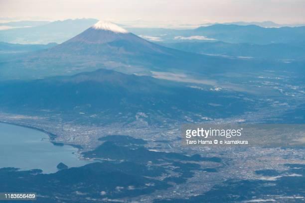 snow-capped mt. fuji and suruga bay in japan aerial view from airplane - mishima city - fotografias e filmes do acervo