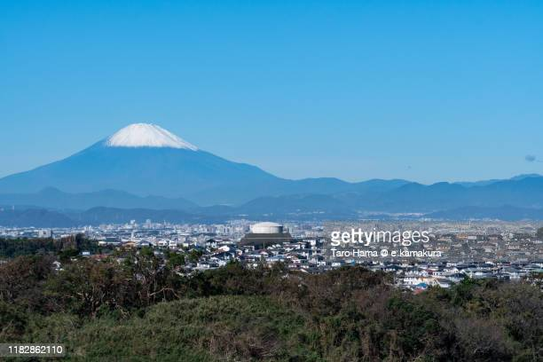 snow-capped mt. fuji and the residential district in kanagawa prefecture of japan - chigasaki stock pictures, royalty-free photos & images