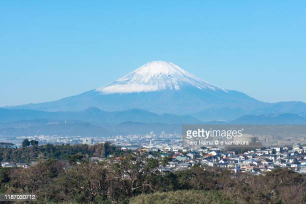 snow-capped mt. fuji and the residential district in kanagawa prefecture of japan - shizuoka stock pictures, royalty-free photos & images