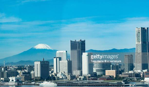snow-capped mt. fuji and yokohama city in kanagawa prefecture of japan aerial view from airplane - kanto region stock pictures, royalty-free photos & images