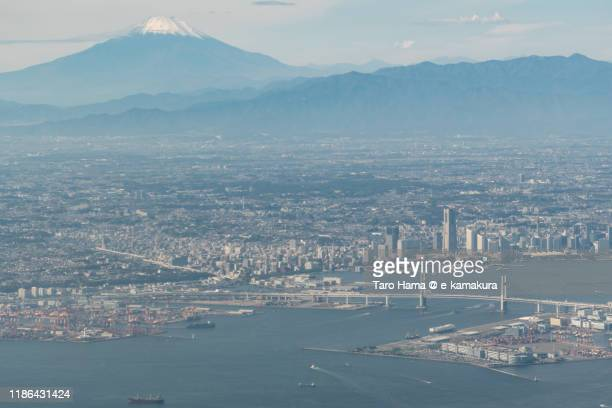snow-capped mt. fuji and yokohama city in kanagawa prefecture of japan aerial view from airplane - 横浜市 ストックフォトと画像