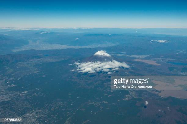 Snow-capped Mt. Fuji in Japan daytime aerial view from airplane