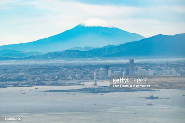 snow-capped mt. fuji, tokyo bay and yokohama city in kanagawa prefecture of japan aerial view from airplane - yokohama stock pictures, royalty-free photos & images