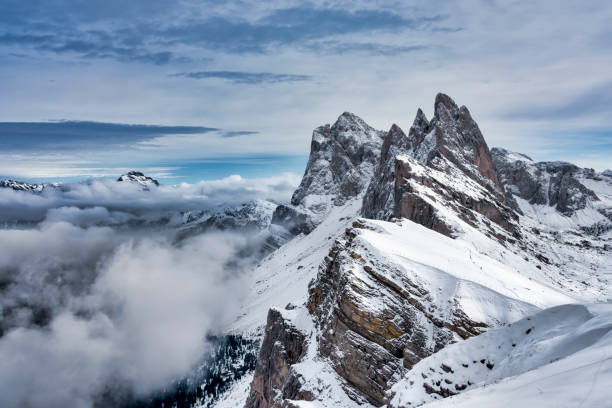 Snowcapped Seceda Mountain peak and Odle group, Gardena Valley, South Tyrol, Italy