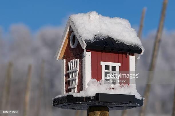 Snowcovered Bird House Dalarna style in Winter