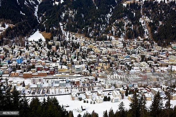 Snowcovered buildings are seen from the Jakobshorn cable car as it travels up the mountain above the town of Davos Switzerland on Monday Jan 13 2014...