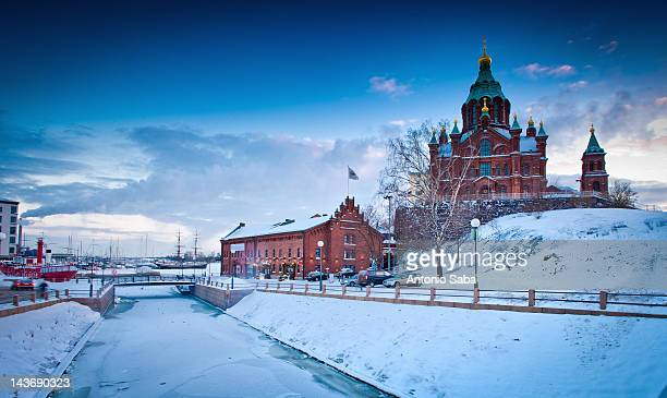 snow-covered castle by frozen river - helsinki stock pictures, royalty-free photos & images