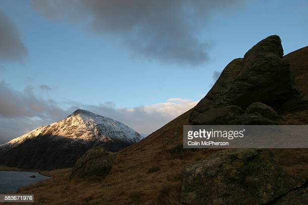 Snowcovered hills in the Snowdonia National Park in north Wales an area popular with hillwalkers climbers and tourists attracted to the area by its...
