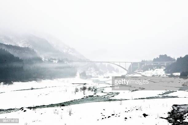 snow-covered river in winter - 富山県 ストックフォトと画像
