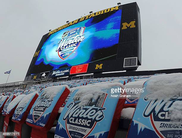 Snow-covered seat cushions cover the upper seating areas during the 2014 Bridgestone NHL Winter Classic on January 1, 2014 at Michigan Stadium in Ann...