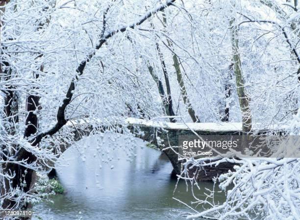 Snow-covered stone bridge