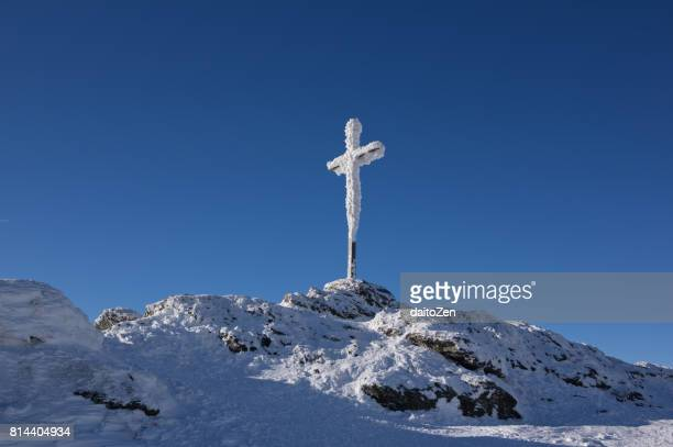 Snow-covered summit cross on Great Arber, Bavarian Forest , Bavaria, Germany