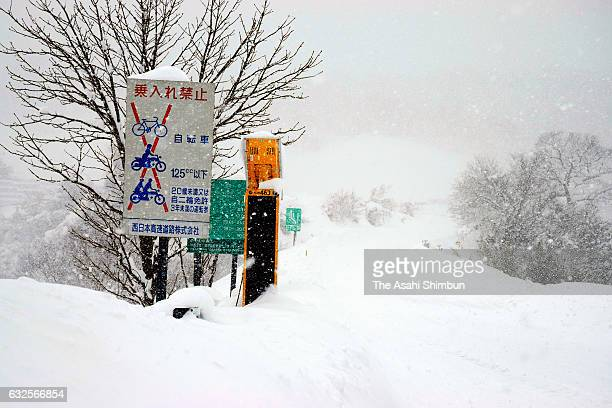 Snow-covered Yonago Expressway Hiruzen Interchange is seen on January 24, 2017 in Maniwa, Okayama, Japan. Heavy snow trapped hundreds of vehicles in...